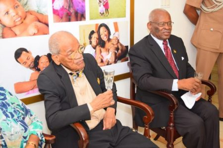 Birthday boy Carlington Millar (left) sitting with Governor General Sir Elliott Belgrave during the celebrations.