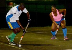 Dario Jordan of Legends under the watchful eye of national captain, Camille Pounder for CM Catering Zionites. The Zionites went on to win the game 5-2. Other scores on the night were, Saltfish 4 - 0 HE's Contractor Services Saints, Eagles 3 - 5 ROGCOL Royals, Strike Force 2 - 2 Spirit.