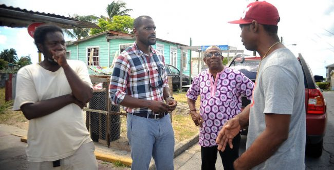 Ronnie Yearwood in Haynesville, St James today speaking to some residents. At second right is St Michael East MP Trevor Prescod.