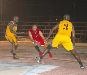 Godfrey Leacock (l) of Dover trying to block Zahir Motara with the assistance of teammate Richard Layne.