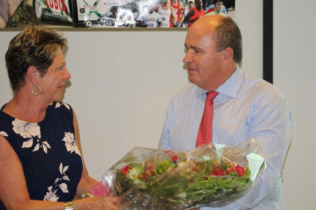 Sue Springer being recognized for her contribution to the tourism sector over the years by chairman of the TDC Martin Ince.