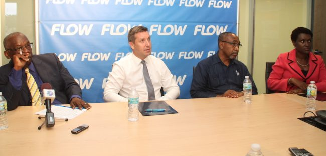 Education Minister Ronald Jones, Managing Director of Flow Barbados Niall Sheehy and Senator Darcy Boyce, Minister in the Office of the Prime Minister Government at yesterday's launch.