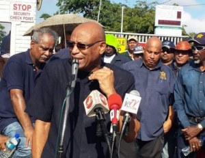 OWTU president general Ancel Roget addressing Petrotrin workers at the Pointe a Pierre roundabout near Marabella on Thursday morning. Photo: Trevor Watson.