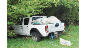 Officers arrested two men Tuesday after they were caught transporting close to 854 pounds of compressed cannabis in this pickup truck.