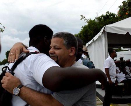 Camilo Rojas, son of a crash victim, hugs a student from Coleridge & Parry School.