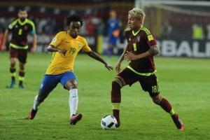 Willian (left) scored Brazil's second goal against Venezuela.