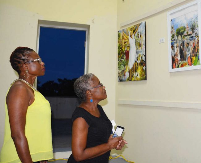 People viewing Coral Bernadine's art.