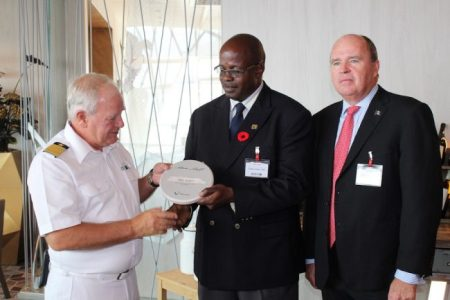 From left, Captain Kjell Holm presenting a plaque to Kenneth Atherley, divisional manager corporate development and strategy at Barbados Port Inc., while chairman of Platinum Port Agency Inc. Martin Ince looks on.