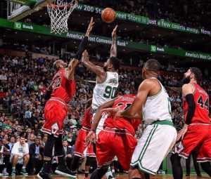 Celtics' Amir Johnson (second left) puts up a shot for two of his 23 points.
