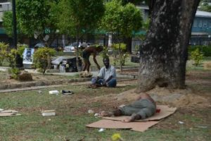 Homeless sleeping in Tamarind Square.