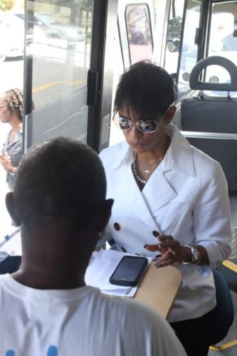 General Manager of Retail Banking for Republic Bank, Sharon Zephirin having her blood sugar tested.