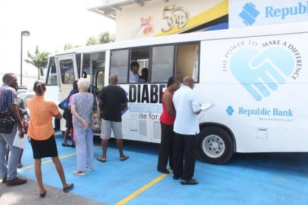 People waiting at the Mobile Testing Unit to have their blood sugar tested.