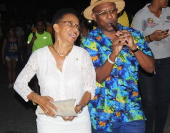 Principal of the University of West Indies Cave Hill Campus Eudine Barriteau dances during the procession to the sweet sounds of Karl Smith of Pomposetters Tuk Band.