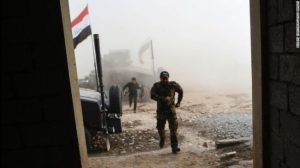 Iraqi dorces run for cover after a mortar shell attack near the village of Bazwaya.