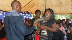 Pastor Lethebo Rabalago has posted photos of him spraying insecticide into his congregants' faces.
