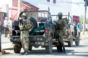 Soldiers on alert during yesterday's operation in Spanish Town.