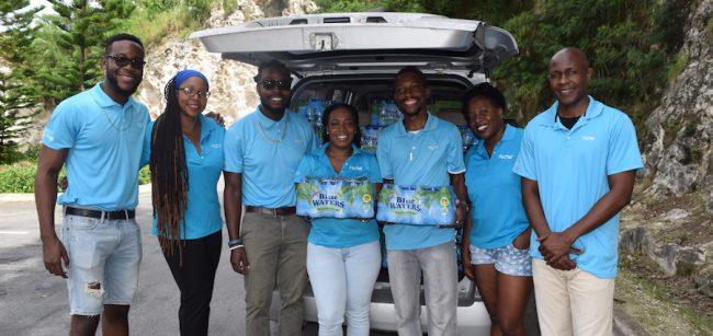 The Dial Team – Dwayne Best, Garvis Samuel-Girard, Rommell Marshall, Melissa Greene, Chris Graham, Nikitia Severin  and Jefferson Skeete all ready to deliver water to St Joseph.