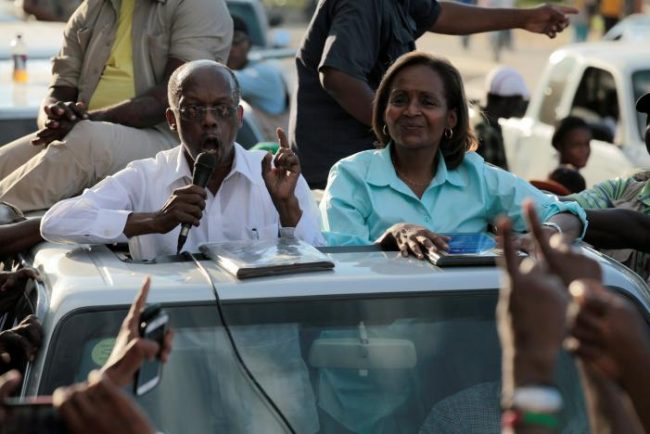 Former President Jean-Bertrand Aristide speaks beside presidential candidate Maryse Narcisse, of Fanmi Lavalas party, during a rally ahead of the presidential election, in a street of Port-au-Prince, Haiti, November 17, 2016. REUTERS/Andres Martinez Casares