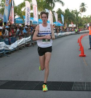 Neil Renault came fifth here in Saturday's 10k and returned yesterday to take third place in the marathon.