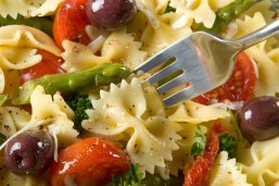Pasta Creation: Bow Tie pasta tossed with tomatoes, olives, asparagus, broccoli, olive oil, crushed garlic , red pepper flakes, and grated cheese.