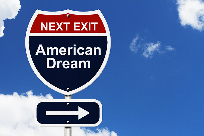 American Dream this way, Blue and Red Interstate Sign with word American Dream and an arrow with sky background