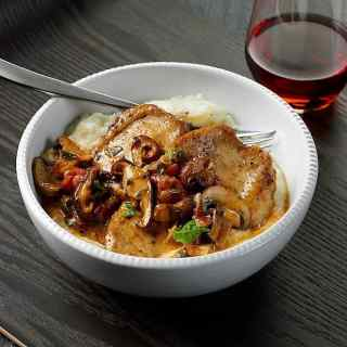 CHICKEN WITH MUSHROOMS AND TOMATOES OVER GARLIC GRITS