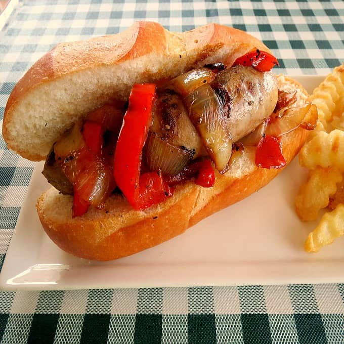 grilled sausage, onion and pepper sandwich
