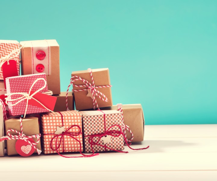 Collection of little handmade gift boxes on blue background