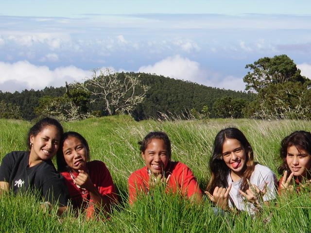 photo of kids on a Puakea Foundatoin camping trip to plant koa trees