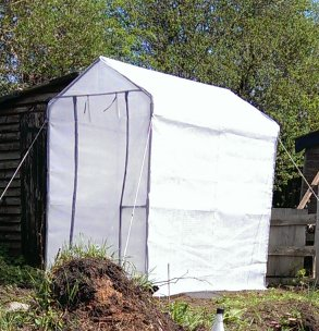 Fabric greenhouse erected and in situ