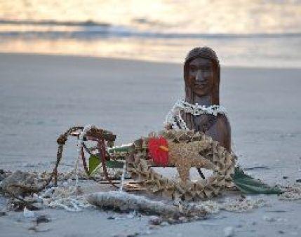 Hawaiian girl on beach with sled_small