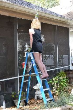spray painting the gutters and painting the trim_small