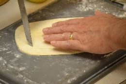 12 keep cutting out layers of puff pastry for coffin_small