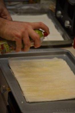 Gordon spraying each layer of filo dough_small