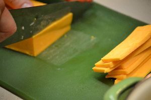 chop cheddar cheese into blocks_small