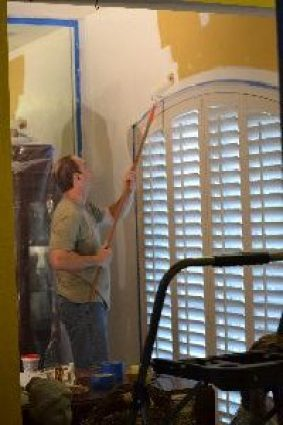 Gordon painting the dining room walls_small