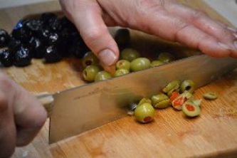 chopping the olives for the stuffed onions_small