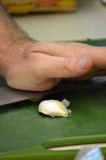 crushing the garlic for slicing_small