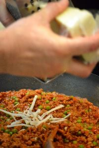 grating the timbale cheeses_small