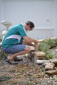 Gordon cutting the blocks to build the wall_small