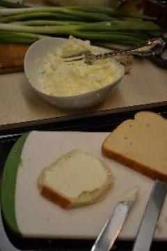 spreading the cream cheese onto the bread_small