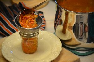 ladeling your relish into sterilized jars_small