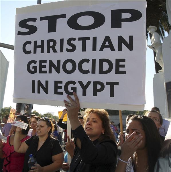 Coptic Christians protest against the killings of people during clashes in Cairo between Christian protesters and military police, in Los Angeles
