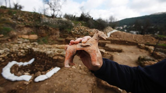 Excavation director Anna Eirikh displays a horse figurine.