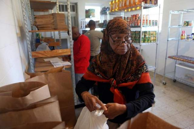 Halimah Muhammed helps prepare bags of food for community Muslim residents at the halal food pantry at  Masjid Al-Mu' Minun mosque in Memphis