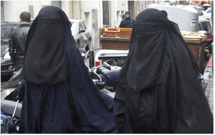 Two burka-wearing bank robbers have pulled off a heist using a handgun concealed beneath their full Islamic veil.