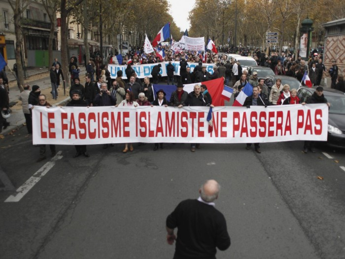 "People hold a banner reading: 'islamic fascism shall not pass"" during a demonstration in Paris, Saturday Nov.10, 2012. France is home to Western Europe's largest population of Muslims, estimated to be at least 5 million"
