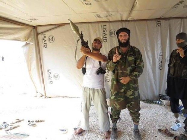 Photograph allegedly shows Islamic State of Iraq and al-Sham (ISIS) linked Commander Muhajireen Kavkaz wa Sham, along with other rebels dawning battle-gear and an RPG, inside a USAID tent.