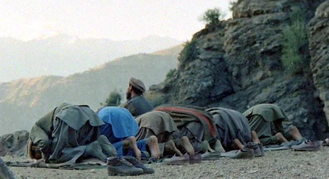 Mujahideen_prayer_in_Shultan_Valley_Kunar,_1987