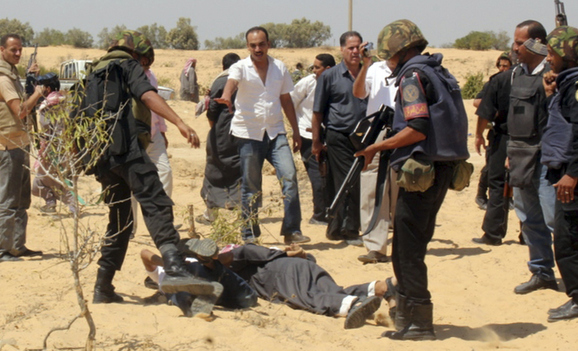 Egyptian security forces arrest suspected militants after a firefight at the al-Goura settlement in Egypt's north Sinai region, near the border with Israel